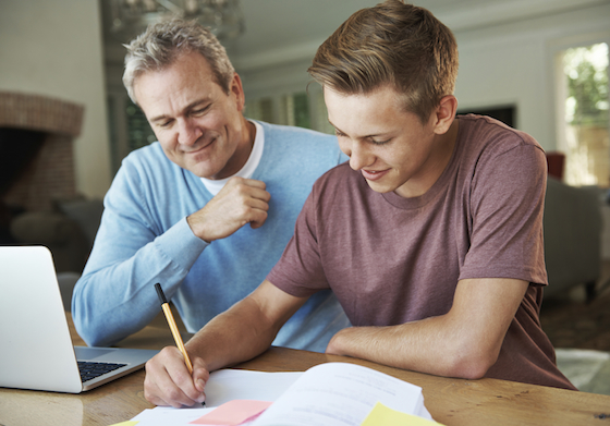 Father helping Son with college applications